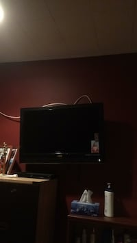 black flat screen TV with black wooden TV stand White Plains, 10606