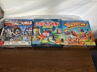 two Monopoly game board boxes Huntsville, 35806