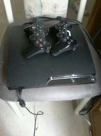 black Sony PS3 slim console with two controllers Regina, S4T 2H8