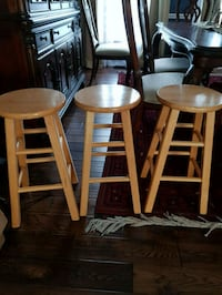 three brown wooden bar stools, counter height 3 mi