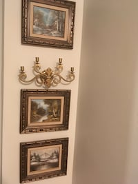 Three oil paintings with one wall candlestick
