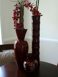 burgandy colored vases with artificial orchids 32 / 24/  inches tall