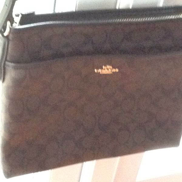 5861434765ee Used Women s brown Coach sling bag for sale in Edgware - letgo