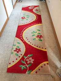 Red, beige, green, and yellow runner rug