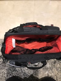 black and red duffel bag Lorraine, J6Z 2W6