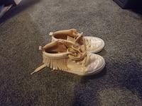 pair of light pink high top sneakers with fringe WASHINGTON