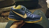unpaired blue and yellow Nike basketball shoe