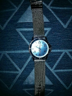 round black and silver analog watch with woven nylon strap