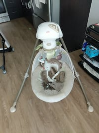 baby's gray and green Fisher-Price cradle n swing