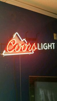 red and white Coors Light neon signage