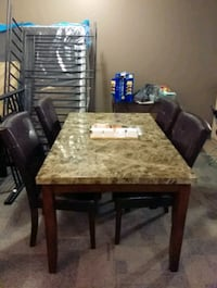rectangular brown wooden table with four chairs Oshawa, L1G 4Y1