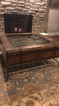 Brown wooden framed glass top coffee table Toronto, M9A