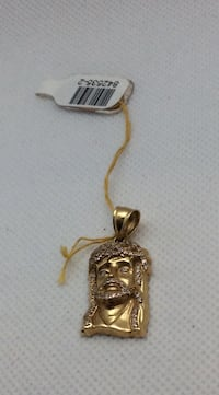 """10kt yellow gold """" Jesus head """" pendant with round CZ 3.4 gr  Baltimore, 21205"""