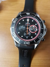 round black and silver chronograph watch with blac