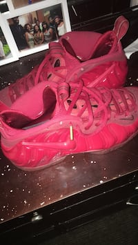 pair of red Nike Foamposite shoes