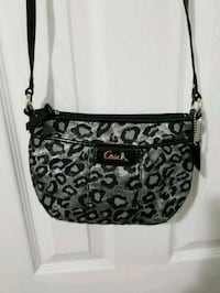 black and gray Coach sling bag New York, 10004