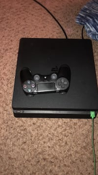 black Sony PS4 console with controller Nicholasville, 40356