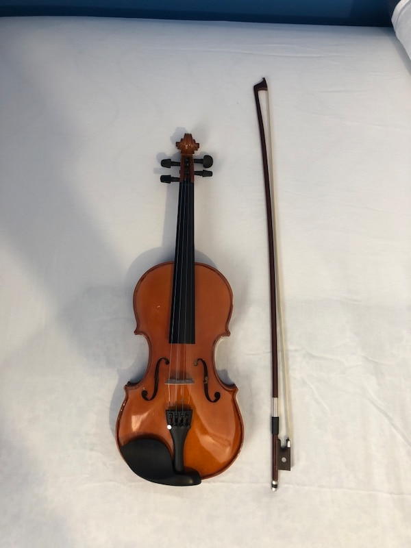 Violin - 3/4, comes with extra strings, bow, & shoulder rest