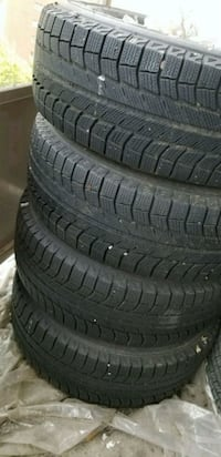four black rubber car tires Toronto, M9W 6K9