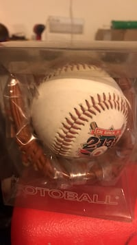 white and red baseball with signature Falling Waters, 25419