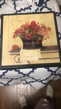 Brown wooden framed painting of flowers
