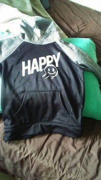black, white, and gray Happy printed pullover hoodie