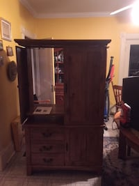 """Very sturdy Armoire in excellent condition will hold a 36-42"""" tv, it has three drawers and 2 shelves"""