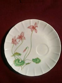 round white and pink floral ceramic plate