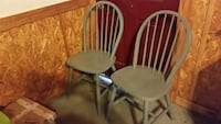 2 gray wooden windsor chairs