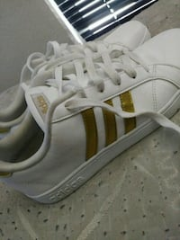 pair of white-and-brown adidas sneakers 2266 mi