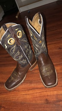 pair of black leather cowboy boots Pasadena, 77505
