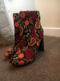 Pair of black boots with flowers  Glasgow City