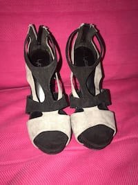pair of black-and-white open toe sandals Germantown, 20876