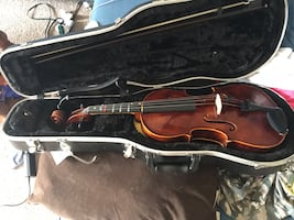 Brown violin with bow in case