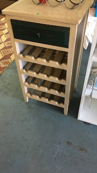 black and brown wooden single-drawer bottle rack