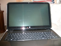 black and gray HP laptop null