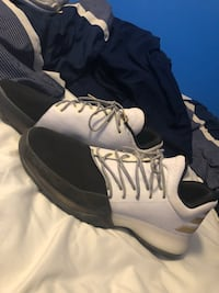 pair of white-and-black Nike basketball shoes Carencro, 70520