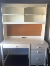 White wooden single pedestal desk with hutch
