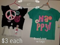 girl's two white-and-black and green t-shirts
