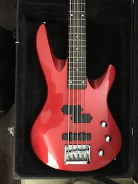 Red 5-string electric bass with black case