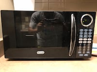 Black and gray sunbean microwave oven Douglasville, 30134