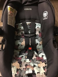black and gray car seat carrier 2870 km