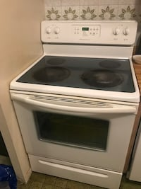 White and black frigidaire induction range oven
