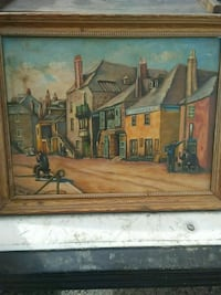 brown wooden framed painting of house 2059 mi