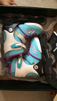 Pair of teal-white-and-black inline skates with box Edmonton, T6L 1J9