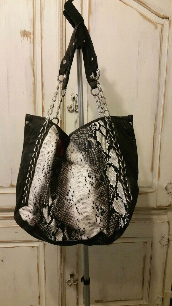 a6442fe5b99d Used Steven Maddeen black and white animal print bag for sale in Lancaster