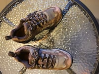 Pair of brown-and-black hiking shoes size 9 1960 km