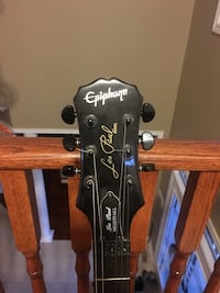 Les Paul epiphone electric guitar was given as a gift and was barely played comes with new strings