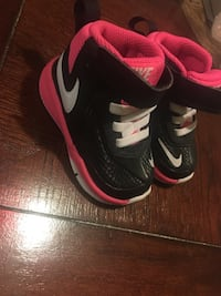 toddler's pair of black-pink-and-white Nike high-top velcro sneakers
