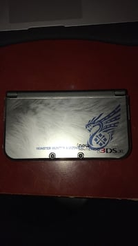 Limited Edition Monster Hunter Ultimate Nintendo 3DS XL (with plastic case, screen protectors, and bottom padding)
